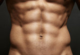 Closeup photo of an athlete with perfect abs