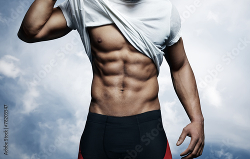 Strong man with athletic body - 78203547