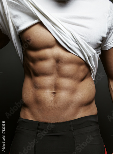 Closeup photo of an athletic guy with perfect abs - 78203581