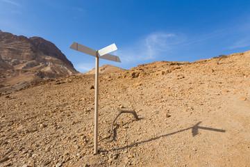 Signpost in desert.