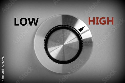 Leinwandbild Motiv Control switch pointing at the word HIGH