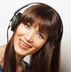 Young happy woman with headphones