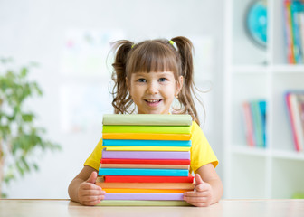 Cute kid girl preschooler with books