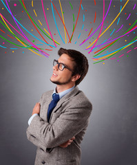 Young man thinking wiht colorful abstract lines overhead