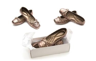 Female beige shoes on shoe box