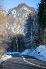 curvy country road in the mountains, winter landscape