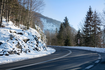 curvy mountain road, winter landscape