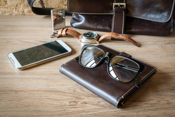 still lift with leather bag, watch , lighter , glasses and smart