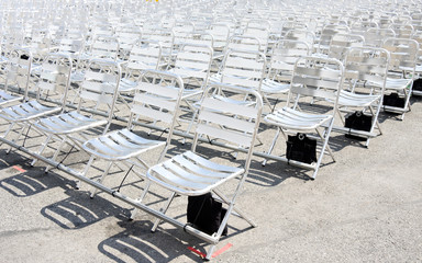 Rows of empty metal chair seats installed for some event