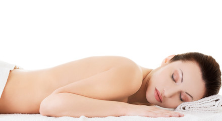 Woman lying on a towel ready to massage