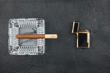 Lighter and glass ashtray with cigar