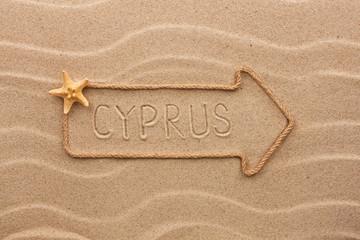 Arrow made of rope and sea shells with the word Cyprus on the sa