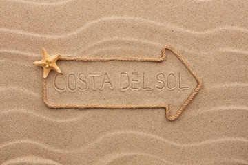 Arrow made of rope and sea shells with the word Costa del Sol on