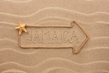 Arrow made of rope and sea shells with the word Jamaica on the s