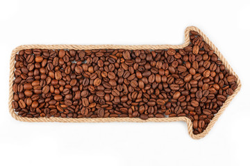 Arrow made of rope with coffee beans