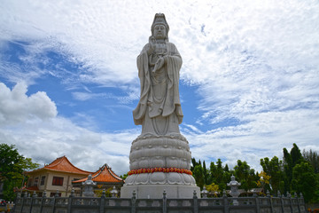 White marble Quan Yin stand near The Bridge of the River Kwai