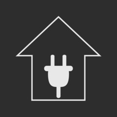 White house with plug on dark grey background