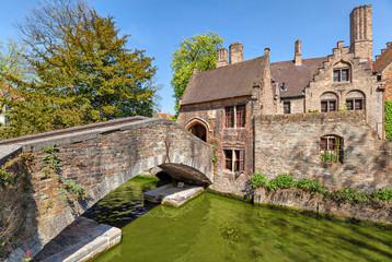 Old bridge and flemish house in Bruges
