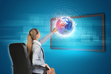 Businesswoman using touch screen interface