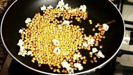Corn cooking  in a pan