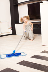 Girl washes a floor mop
