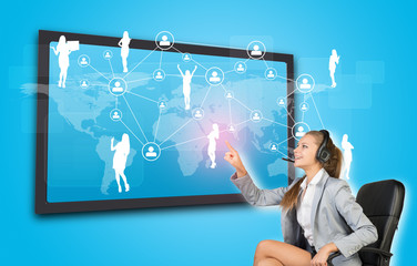 Businesswoman in headset using touch screen interface