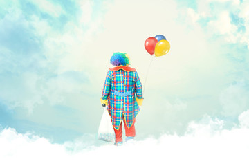 clown with balloons lost in the clouds