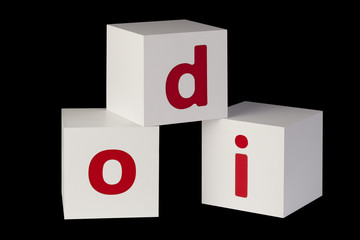 white cubes with letters isolated on black