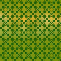Golden clover leaves on a green background