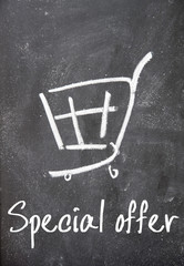 special offer text and shopping cart sign on blackboard