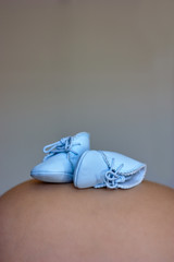 Baby Shoes on Pregnant