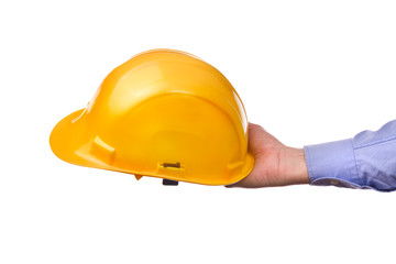 Male worker's hand holding yellow industrial protective helmet.