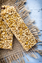 Muesli bars, cereal bars on the wooden background.