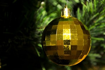 Golden ball as Christmas tree decoration
