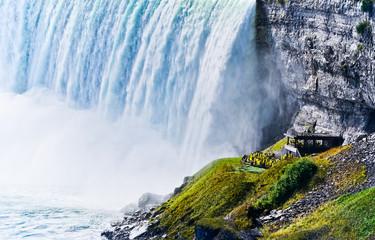 Tourists visiting under Niagara Falls