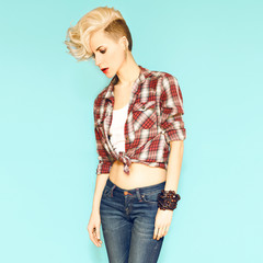 Fashionable young blond woman with stylish hairstyle on blue bac