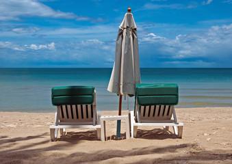Umbrella and sun loungers