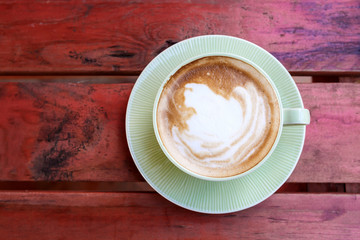 Coffee cup on red table