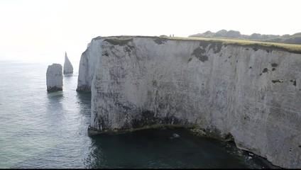 Tiny people big chalk cliffs Studland Dorset England UK