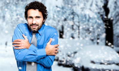 Portrait of a frozen businessman in the cold winter