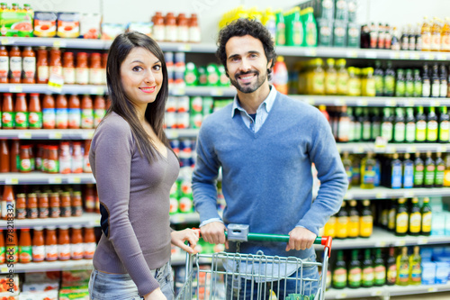 canvas print picture Young couple shopping at the supermarket
