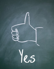 yes gesture sign on blackboard