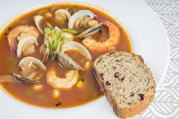 Spicy Seafood Soup Served with Bread