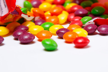 Openned pack with skittles in it