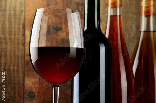 canvas print picture Composition with glass and bottles of wine