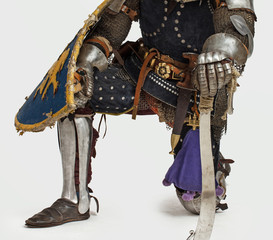 Knight is standing on one knee