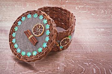 opened empty wicker basket on old wooden board