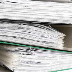 Stack of file folders with documents