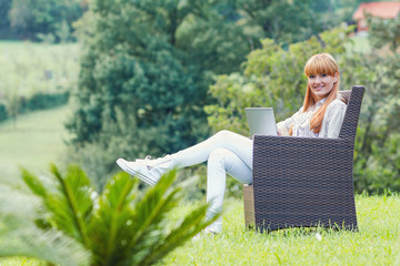 Young happy woman using laptop