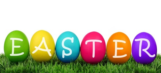 Colorful eggs on grass with Easter text over white